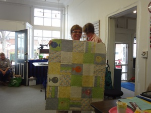 """Hazel calls this her """"New Life"""" baby quilt with appliqued fishies and seahorse quilting."""
