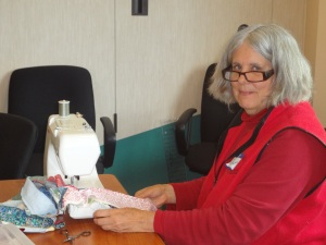 "Janet is busy sewing up her 1600"" jelly roll quilt from Heirloom Creations"