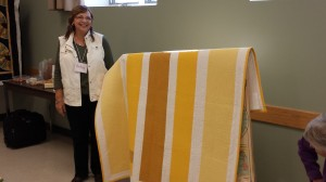 "Betsy discusses the straight line quilting on her modern quilt, ""Mustard"", designed by Alissa Haight Carlton, Executive Director of The Modern Quilt Guild."