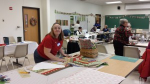 Vicky W., incoming Secretary, working on a Christmas table skirt