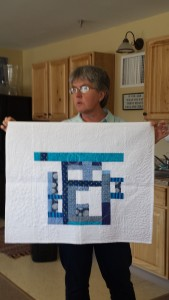 Jen Johnson shows a work of art with all her beautiful modern quilting.
