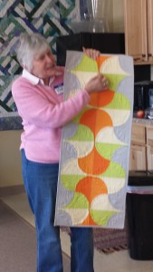Karen Bean's modern curved piecing and dynamic colors in a table runner.