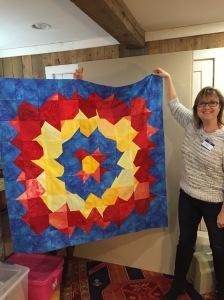 Denise showed her Supernova quilt.